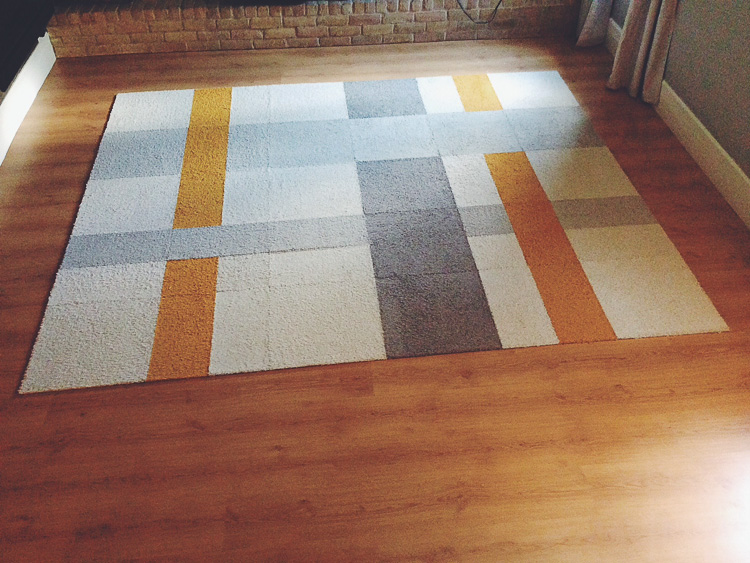 A Flor Area Rug In Our Living Room